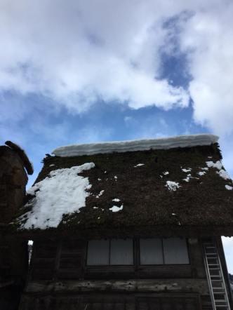 A gasshou zukuri house covered in snow